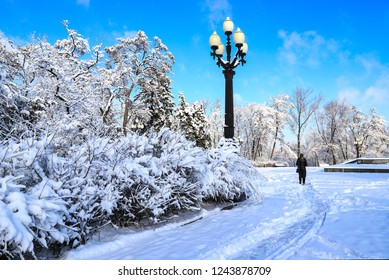 A picturesque  winter landscape, park covered with snow, with a beautiful lantern in the Dnipro city ,Dnepropetrovsk, Dnepr, Dnipropetrovsk,Ukraine
