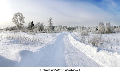 Picturesque winter landscape with a road