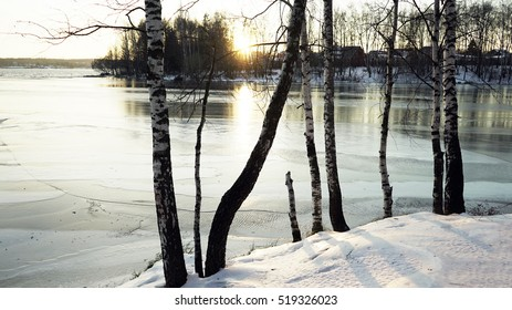 Picturesque winter park and river under the ice
