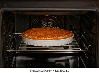 Pie with apple and lemon is baked in the oven