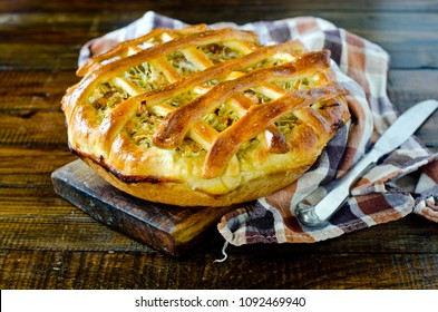 Pie with cabbage and vegetables