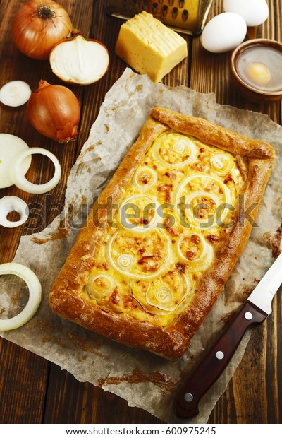 Pie with cheese and onion on the table