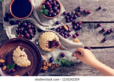 Pie with gooseberry. Rustic style. pie with fresh garden berries over grunge rusty metal background, top view, copy space. Summer pie with berries.