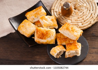 Pie made from puff pastry with meat on plate