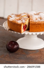 Pie with plums in powdered sugar.selective focus