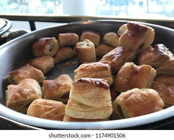 pie of puffs with sausage in a serving tray,coffee break.