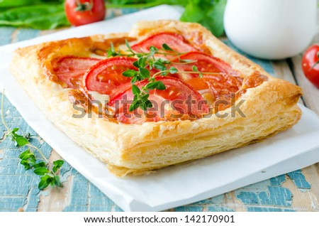 Pie with tomatoes and cheese . Selective focus