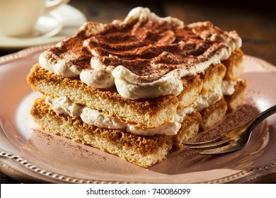 Piece of appetizing tiramisu cake on plate in close up