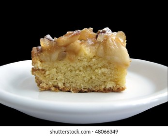 piece of apple pie lying on a white dish