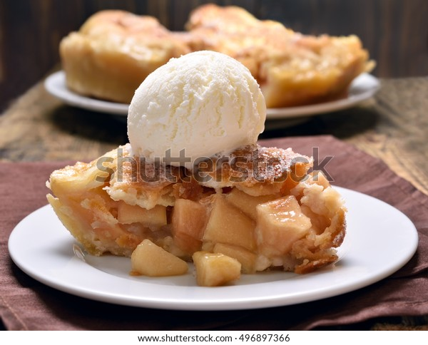 Piece of apple pie served with ice cream, close up view