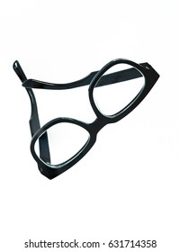 A piece of black eyeglasses floating in the air