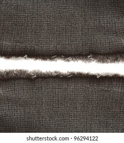 Piece of black jeans fabric with fringe on white