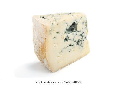 Piece of blue cheese isolated on white background. Side view, close up.