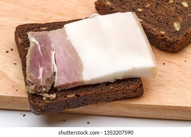 A piece of brackish bacon on rye bread