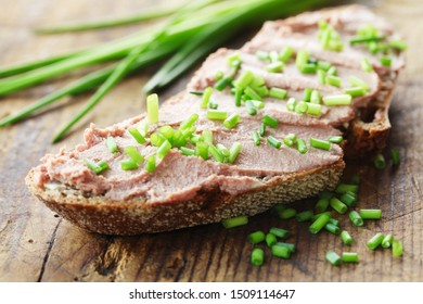 A Piece Of Bread With Liver Pate And Chives