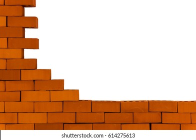 A piece of a brick wall on a white background. Unfinished brick wall.