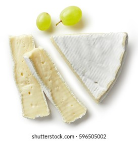 Piece of brie cheese isolated on white background. From top view