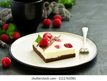 piece of brownie with schekake with raspberries.