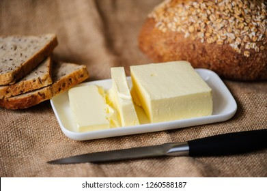 piece of butter with bread on a sacking textile material