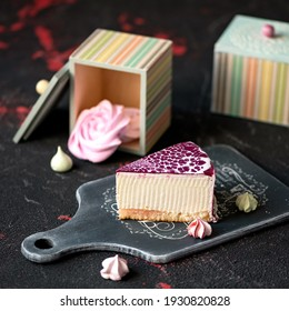 Piece of cake or cheesecake for loved person or woman. Sweet gift for holiday. Food concept. Square format or 1x1 for posting on social media.