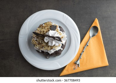 Piece of cake on the wooden table, top view