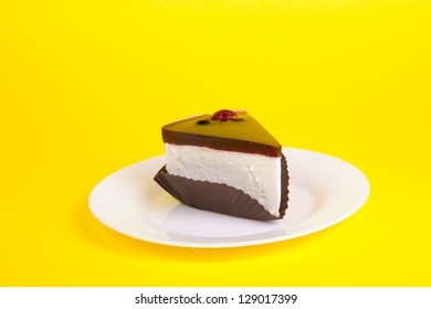 Piece of cake on the yellow background
