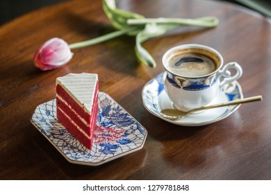"""Piece of cake """"Red Velvet"""" with cup of coffee in cozy cafe at Phuket town, Thailand."""
