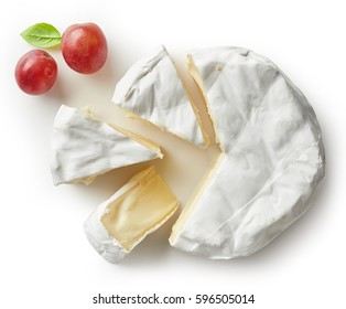 Piece of camembert cheese isolated on white background. From top view