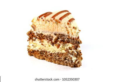 Piece of caramel crunch cake isolated on white, shallow focus