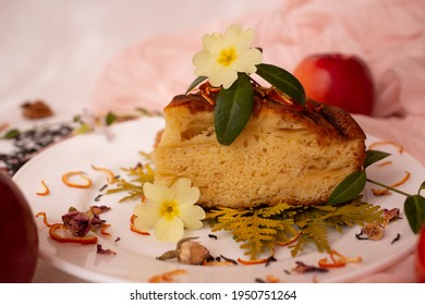 A piece of Charlotte decorated with flowers and orange peel