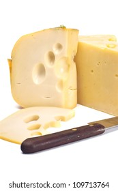 Piece of cheese with a knife on a white background close up