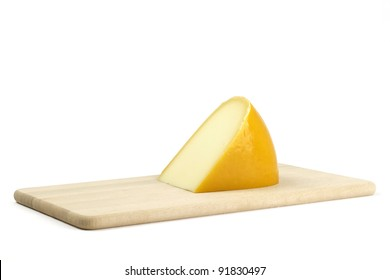 piece of cheese on a board