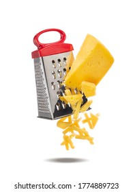 Piece of cheese is rubbed on metal hand grater. Slices of cheese and grater levitate in air. Grater and cheese isolated on white background.