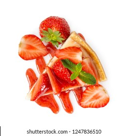 Piece of cheesecake with fresh strawberries and mint isolated on white background. Top view.
