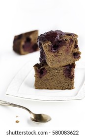 A piece of chocolate brownie with cherries