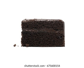A piece of chocolate cake with crumbs on front view isolated on white background