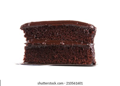 Piece of chocolate cake isolated on white background.