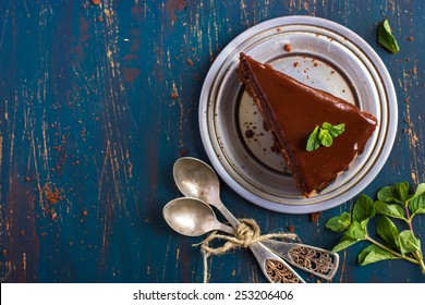 piece of chocolate cake with mint leaves, top view
