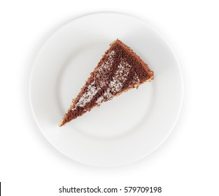 Piece of chocolate cake in plate isolated on white background. Top view.