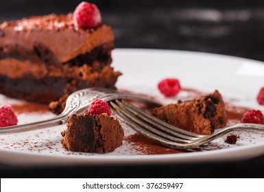Piece of chocolate cake with raspberry on a dark background.selective focus.