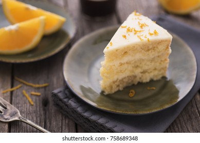 A piece of citrus cake on old table