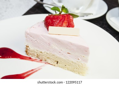 piece of cream cake with strawberry and mint