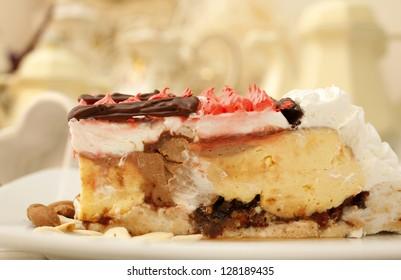Piece of creamy fruit cake with chocolate