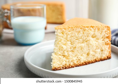 Piece of delicious fresh homemade cake on light grey marble table
