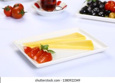 Piece of Emmental, Emmentaler or Emmenthal cheese on plate