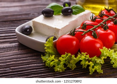 A piece of feta cheese on a wooden rustic background