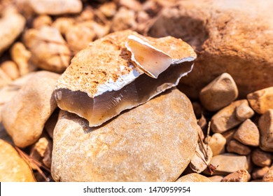Piece of a flint stone, silex, used in prehistory as a tool.