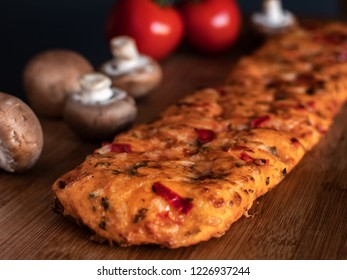 Piece of Focaccia flat oven-baked Italian bread on the table
