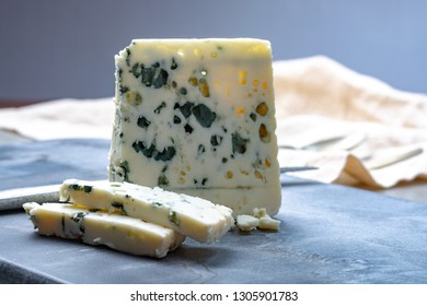 Piece of French blue cheese Roquefort, made from sheep milk in caves of Roquefort-sur-Soulzon
