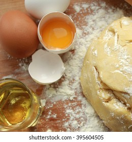 A piece of fresh yeast dough. The dough is made from eggs, flour and olive oil.